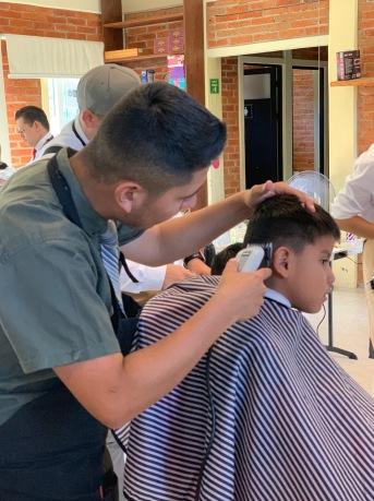 Hecho Hombre's barbers give classy cuts to youngsters at the community center Fundación Comunitaria Don Diego at Colonia Presa de la Cantera.