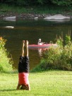 Rose performing yoga as unsuspecting kayakers pass on the Clarion River. They were looking for wildlife ... and found it!